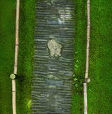 Bending stone path, Japanese Garden. Top view Royalty Free Stock Photo