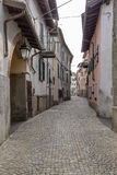 Bending street and old houses at Rocca Grimalda, Italy Stock Photo