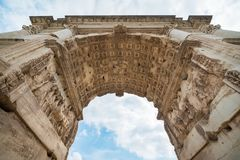 Beneath the Arch of Titus. At The Roman Forum in Rome, Italy Royalty Free Stock Photos