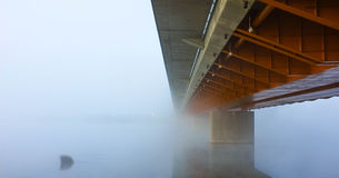 Beneath the bridge. Riga Southern bridge in misty morning Royalty Free Stock Images