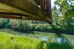 Beneath The Bridge. A view from beneath a rusty metal walking bridge that spans the Green River in Kent, Washington Stock Photography