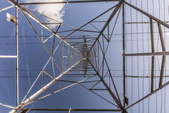 Beneath an Electricity Pylon Royalty Free Stock Photography