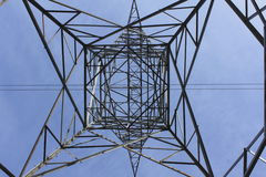 Beneath a Hydro Transmission Tower. Looking up and standing beneath a giant hydro transmission tower stock photography