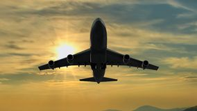 Landing Airplane silhouette at Sunset. Beneath a Landing Airplane silhouette at Sunset Royalty Free Stock Photography
