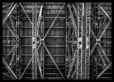 Beneath the Sydney Harbour Bridge. The intricate and symmetrical design of the Sydney Harbour Bridge is evident in this shot taken from beneath the massive Royalty Free Stock Photography