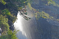 Beneath a waterfall in Glacier National Park. Royalty Free Stock Photography