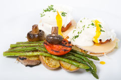 Benedict eggs with asparagus Royalty Free Stock Image