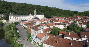 Benedictine Abbey of Brantome and river and surrounding. Aerial view of Benedictine Abbey of Brantome and river and surrounding stock footage