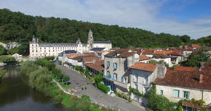 Benedictine Abbey of Brantome and river and surrounding. Aerial view of Benedictine Abbey of Brantome and river and surrounding stock video