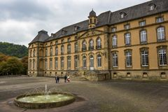 Benedictine Abbey of Echternach, the oldest town in Luxembourg, exterior view with a fountain royalty free stock images