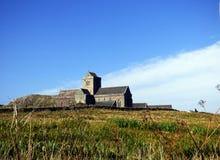 Benedictine Abbey of Iona, Isle of Iona, Scotland. View of the medieval Benedictine Abbey of Iona, on the Isle of Iona, Scotland, seen from the fields below the Royalty Free Stock Photo