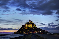 Benedictine Abbey of Mont St Michel in Normandy, France. Monst St Michel in Normandy, France during low-tide lit up at night Stock Image