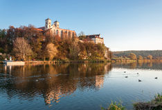 Benedictine abbey in Tyniec in fall, Krakow, Poland. Benedictine monastery and on the rocky hill in Tyniec near Cracow, Poland, Vistula river and wild ducks in Stock Image