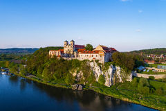 Benedictine abbey in Tyniec, Poland. Benedictine monastery on the rocky hill in Tyniec near Cracow, Poland and Vistula River. Aerial view at sunset stock photography