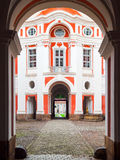Benedictine Monastery in Broumov. Main courtyard with entrance gate. Czech Republic.  Stock Images