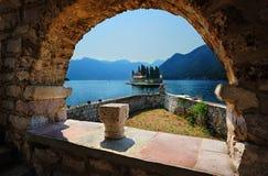Benedictine monastery in Perast. View through the arch to the Benedictine monastery on the island in Perast, Montenegro Stock Photos