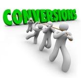 Beneficios de Team Pulling Together Increasing Sales de la palabra de las conversiones Imágenes de archivo libres de regalías