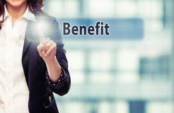 Benefit. Business woman pressing Benefit button at her office Stock Image