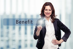 Benefit. Business woman pressing Benefit button at her office. Toned photo Royalty Free Stock Photography