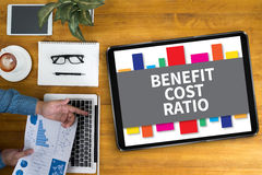 BENEFIT COST RATIO. Businessman working at BENEFIT COST RATIO p view Stock Photo