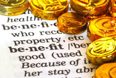 The Benefit of Wealth. The word Benefit in the dictionary next to gold coins Stock Photography