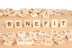 Benefit ,word written on wood cube Royalty Free Stock Photo