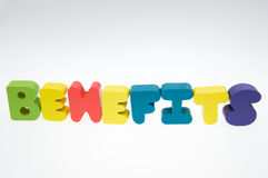 Benefits. Wooden letters spelling the word benefits on white background stock photography