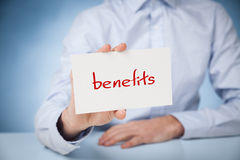 Benefits. Businessman show on card text benefits royalty free stock photos