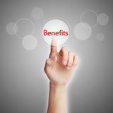 Benefits concept. Hand pressing virtual button of Benefits with gray background stock photography