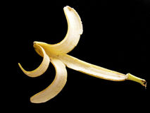 The benefits of eating banana and plantain paintings. Slippery banana peel pictures Royalty Free Stock Photography