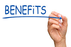 Benefits - female hand writing blue text with marker. On white background Stock Image