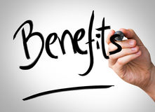 Benefits Hand writing with a black mark on a transparent board Stock Images