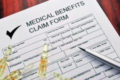 benefits läkarundersökning för reklamationsdatalista Arkivfoto
