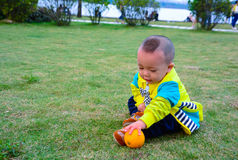 The benefits of orange fruit to the growth of children Stock Image