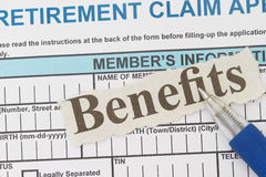 Benefits. Retirement application form with benefits newspaper cutout stock images