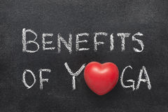 Benefits of Yoga. Phrase handwritten on chalkboard with heart symbol instead of O Royalty Free Stock Photo