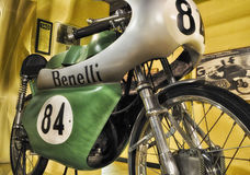 BENELLI GRAND PRIX  VINTAGE motorcycle AND LOGO IN MUSEUM. PESARO -ITALY - NOV. 2016: BENELLI GRAND PRIX  VINTAGE motorcycle AND LOGO IN MUSEUM Royalty Free Stock Images