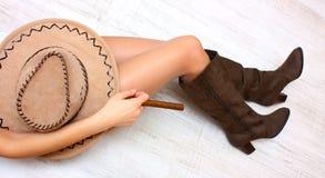 Benen, laarzen, hoed en sigaar Stock Fotografie