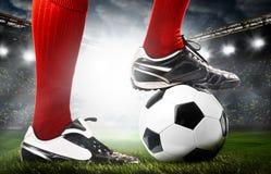Benen van een voetballer royalty-vrije stock afbeeldingen