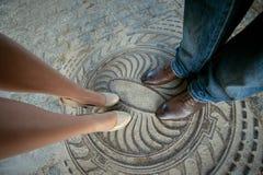 Benenman en vrouw Stock Fotografie