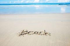 Benennung des Strandes auf Sand stockfotografie