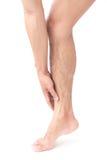Benet för ankeln för manhanden smärtar det hållande med vit bakgrund arkivbilder