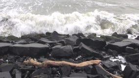 Bengal bay sea waves and black coast stone, India Stock Images