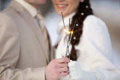 Bengal fire or Sparkler in hands of man and woman Stock Photos