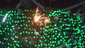 Bengal fires, sparklers and colorful bokeh christmas, new year background. stock video