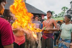 fire play ritual during gajan festival