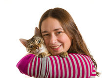 Bengal kitten on arm of young girl facing camera Royalty Free Stock Photo