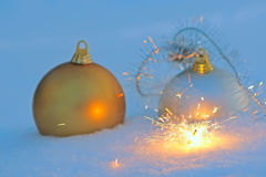 Bengal light and christmas balls  in snow Stock Photography