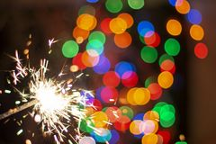 Bengal lights on the background of beautiful bokeh, background royalty free stock photography