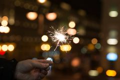 Bengal lights, sparkle background. Christmas time, new year. Outdoor Royalty Free Stock Image